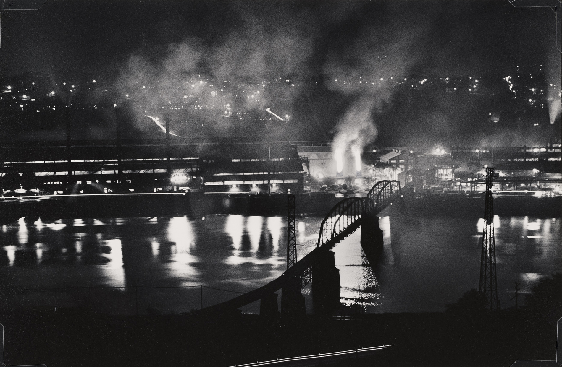 W. Eugene Smith, USA, 1918-1978 National Tube Company works, U.S. Steel Corporation, McKeesport, and Union Railroad Bridge over the Monongahela River, 1955-1957 gelatin silver print,  Carnegie Museum of Art, Pittsburgh Gift of the Carnegie Library of Pittsburgh, Lorant Collection. © W. Eugene Smith / Magnum Photos