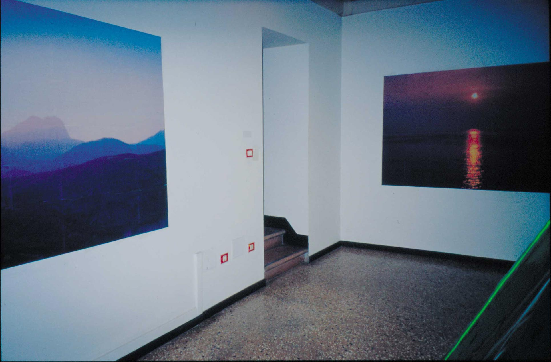 Detail: the two photographs glued directly on the wall in single sheets