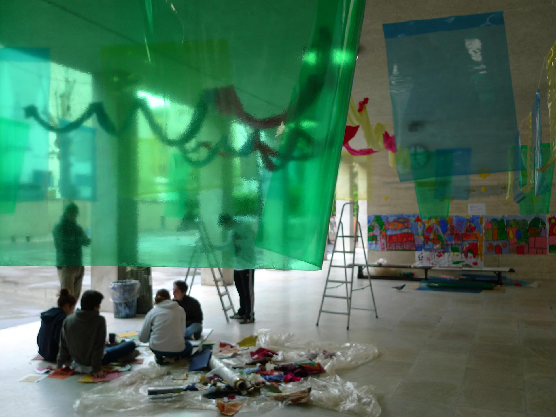 Color placed in the space in an installation with fabric and colored transparent film