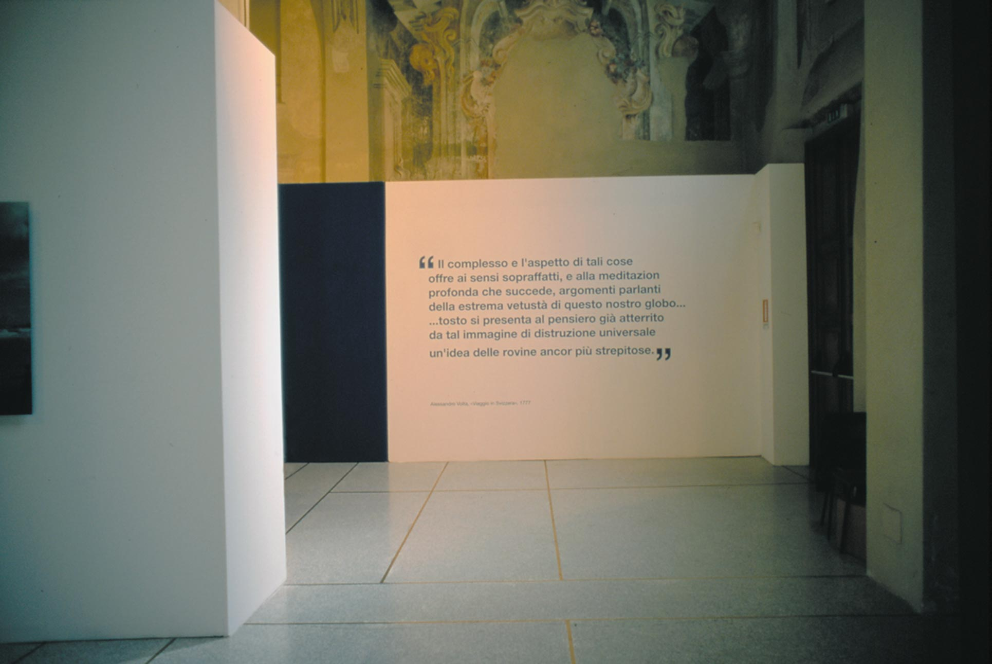 Exhibition view, San Pietro in Atrio Como, installation with wall painting and sentences from Alessandro Volta's diary